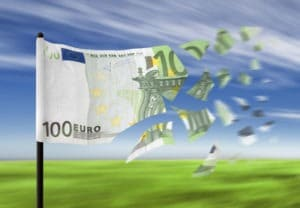 Euro banknote paper money falling into pieces in the wind.